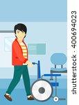 man pushing wheelchair. | Shutterstock .eps vector #400694023