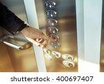 finger presses the elevator... | Shutterstock . vector #400697407