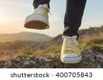 woman on a hiking trip with... | Shutterstock . vector #400705843