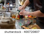 bartender pours alcoholic drink ... | Shutterstock . vector #400720807