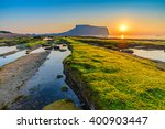 sunrise at jeju do seongsan... | Shutterstock . vector #400903447