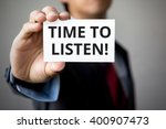 businessman presenting 'time to ... | Shutterstock . vector #400907473