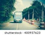 old bus running on road | Shutterstock . vector #400937623