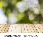 wooden floor with green bokeh  | Shutterstock . vector #400942027