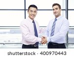 two businessmen  one asian and... | Shutterstock . vector #400970443