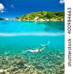 woman with mask snorkeling in... | Shutterstock . vector #400984663