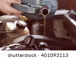 fresh oil being poured during...   Shutterstock . vector #401093113