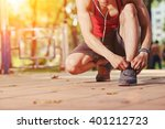 jogger tying shoe laces before... | Shutterstock . vector #401212723
