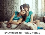 two girls in blue t shirts... | Shutterstock . vector #401274817