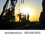 oil field oil workers at work | Shutterstock . vector #401462443