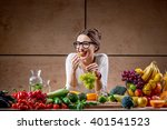 Young And Cute Woman Eating...