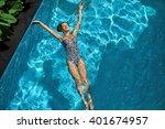 woman in pool water. beautiful... | Shutterstock . vector #401674957