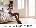 young black woman stretching at ... | Shutterstock . vector #401699023