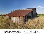 An Old Barn Weathers In The...