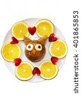 Small photo of Directly above shot of bran muffin with orange slices in plate over white background