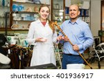 orthopedist consulting elderly... | Shutterstock . vector #401936917
