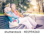 senior cheerful couple sitting... | Shutterstock . vector #401954263