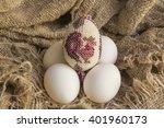 souvenir beaded egg on white... | Shutterstock . vector #401960173