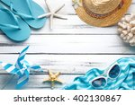 straw hat towel and beach... | Shutterstock . vector #402130867