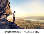 asia tourist on the sharp peak... | Shutterstock . vector #402186487