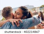 woman greeting her boyfriend... | Shutterstock . vector #402214867