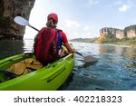 young lady sits in the kayak... | Shutterstock . vector #402218323