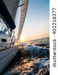 yacht sailing in open sea at... | Shutterstock . vector #402218377