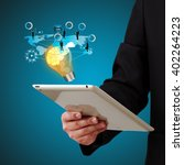 businessman holding a tablet ... | Shutterstock . vector #402264223