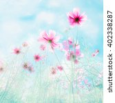 soft blur of cosmos flowers in... | Shutterstock . vector #402338287