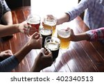 friends drinking beer in pub | Shutterstock . vector #402340513