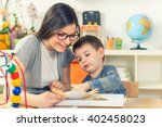 teacher and child playing and... | Shutterstock . vector #402458023