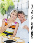 portrait of couple with coffee... | Shutterstock . vector #402459763