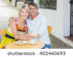 portrait of couple sitting with ... | Shutterstock . vector #402460693