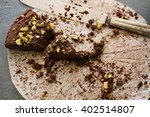 crumbling last piece of dark... | Shutterstock . vector #402514807