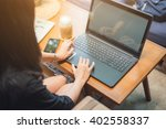 woman using laptop computer.... | Shutterstock . vector #402558337