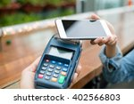 woman use of mobile phone to pay | Shutterstock . vector #402566803