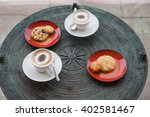 Small photo of Cappuccino in white circles with cookies, anasa on a table