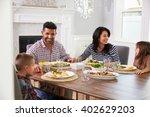 hispanic family enjoying meal... | Shutterstock . vector #402629203