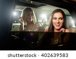 two glamorous women laughing in ... | Shutterstock . vector #402639583
