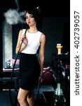 young  beautiful woman smokes a ... | Shutterstock . vector #402739057