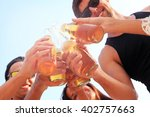 happy young friends drinking... | Shutterstock . vector #402757663