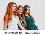 smiling girlfriends sisters | Shutterstock . vector #402892603
