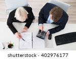 two young businesspeople... | Shutterstock . vector #402976177