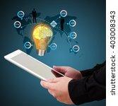 businessman holding a tablet ... | Shutterstock . vector #403008343