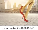woman legs red heels and city  | Shutterstock . vector #403015543