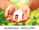 man hands holding paper house | Shutterstock . vector #403111987