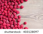 Raspberries On Wooden...