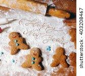 cookie figures on flour... | Shutterstock . vector #403208467