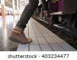 traveler feet step up to a... | Shutterstock . vector #403234477
