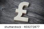wooden pound sterling symbol on ... | Shutterstock . vector #403272877